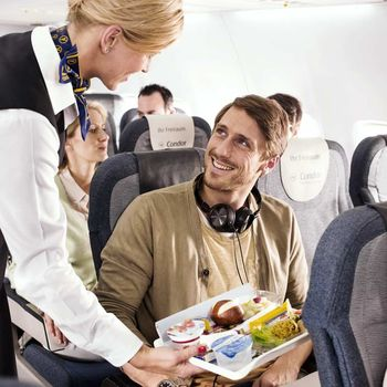Stewardess serving food